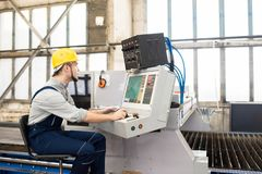 Factory operator working on control panel of manufacturing machi royalty free stock photo