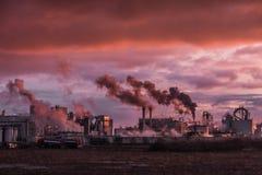Factory, chimney, sunset, smoke. Factory outside city, smoke and clouds stock photo