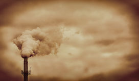 Factory pipe. Smoke pollution with orange sky Royalty Free Stock Images
