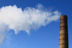 The factory pipe. On blue sky background Royalty Free Stock Photography