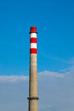 Factory pipe. Factory chimney against the blue sky Royalty Free Stock Images