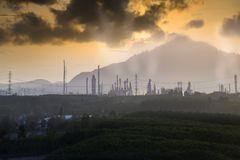 Factory pipe polluting air against sunset, environmental problems, smoke from chimneys . Pollution industry , Factory pipe polluting air against sunset Stock Images
