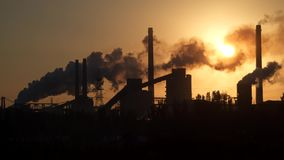Factory pipe polluting air at sunrise. Environmental Problems stock footage