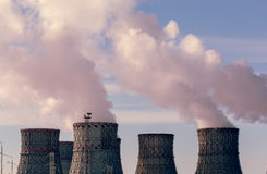 Factory pipes or Cooling towers of nuclear power plant with steam. Environmental. Pollution concept stock photography