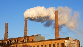 Factory plant smoke stack over blue sky background. Energy generation and air environment pollution industrial scene. 4K UHD video footage stock video
