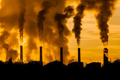 Factory plants. Chemical factory with smoke stack Royalty Free Stock Image