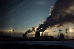 Factory pollutes the atmosphere harmful emissions stock images