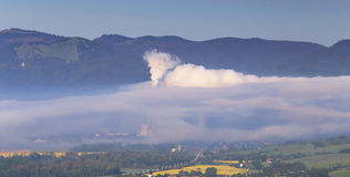 Factory pollutes clean air Stock Photography