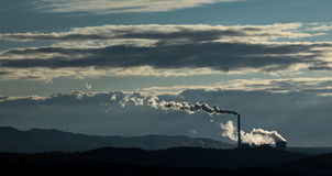 Factory polluting the environment Royalty Free Stock Image