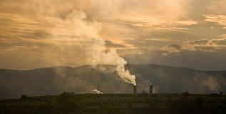 Factory pollution. A factory producing smoke royalty free stock photography
