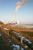 Factory pollution landscape. Factory with smoke in early spring in the evening just before sunset, polution Royalty Free Stock Photos