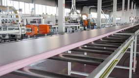 Factory, polyurethane on conveyer line in vivid indoors with large windows and modern equipment. Factory, polyurethane on conveyer line in job in vivid indoors stock footage