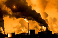 Factory Power Generation Plant Pollution in the Air or Atmosphere. Power plant or factory generating pollution in the air or atmosphere stock photo