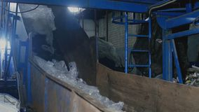 Old garbage recycling company, polyethylene bags in conveyor. Factory for the processing of domestic waste, garbage factory, garbage recycling company stock video footage
