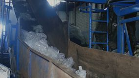 Old factory for the processing of domestic waste in the form of polyethylene. Factory for the processing of domestic waste, garbage factory, garbage recycling stock footage