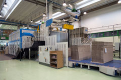 Factory - Production of cardboard foodstuff containers. Automatic machines for the production and printing of cardboard foodstuff containers (mainly  pizza boxes Royalty Free Stock Photo