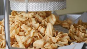 Factory production of fried corn snacks Stock Image