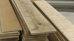 Factory for the production of laminate floor panel stock footage