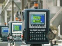 Factory production line. Heavy machines and digital displays in production line of a factory stock images