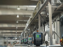 Factory production line. Heavy machines and digital displays in production line of a factory stock image
