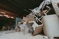 Factory for Production of plaster molds. cluttered dusty old warehouse at night Stock Photography