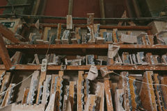 Factory for Production of plaster molds. cluttered dusty old warehouse at night Stock Images