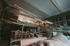 Factory for Production of plaster molds. cluttered dusty old warehouse at night Royalty Free Stock Image