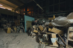 Factory for Production of plaster molds. cluttered dusty old warehouse at night Stock Photo