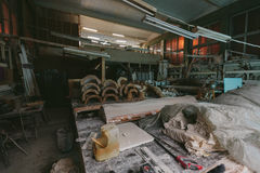 Factory for Production of plaster molds. cluttered dusty old warehouse at night Stock Photos