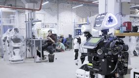 Factory for the production of robots. The robot is worth disassembled, smiling stock video footage