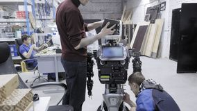 Factory for the production of robots. Two engineers are examining a robot. Creates a new robot in the lab. Connect the