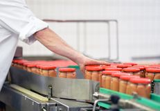Factory for the production of sausages - packaging of sausages i. N tin cans Stock Photo