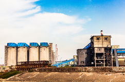 Factory raw material warehouse. A Chinese steel plant raw material storage and transportation Royalty Free Stock Image