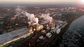 Factory in the rays of the rising sun. bird`s eye view. environmental pollution royalty free stock photo