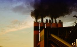Factory releasing air pollution Royalty Free Stock Image
