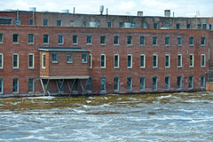 Factory in rising flood waters Stock Photography