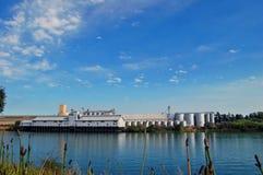Factory on the river. A factory or grain silo on the Sacramento Delta Stock Photography