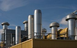 Factory rooftop heating and ventilation Royalty Free Stock Photo
