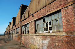 Factory Ruins. Wide angle view of an old abandoned factory building royalty free stock photo