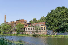 Factory ruins on river bank royalty free stock image