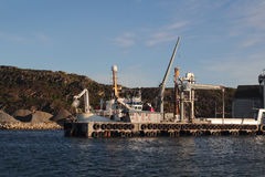 Factory's  pier of  Bodø Stock Images