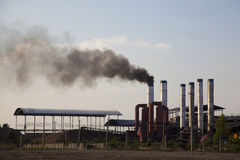 Factory sends black smoke in to sky Stock Images