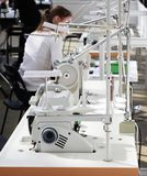 Factory about sewing clothes. People and sewing machines at a garment factory. Textile industry. Sewing factory royalty free stock photography