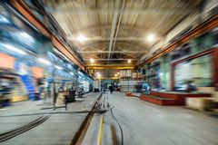 Factory shop. Abstract industrial background, motion blur effect. Royalty Free Stock Image