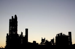 Factory Silhouette with Copy Space. A silhouette of a factory in the evening with copy space above Royalty Free Stock Photography
