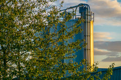 Factory silos at sunset Royalty Free Stock Photo