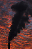 Factory smoke. Factory smoking in sunset sky Royalty Free Stock Photo