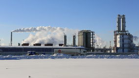 Factory, smoke and blue sky in winter morning stock footage