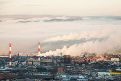 Factory smoke early in the morning. Royalty Free Stock Photos