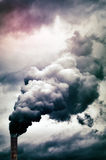 Factory smoke emission. Dense smoke emission from factory pipe stock image